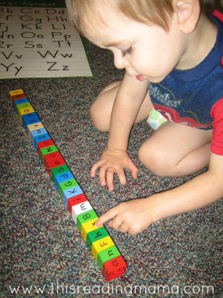 writing letters on DUPLO LEGO bricks for toddlers