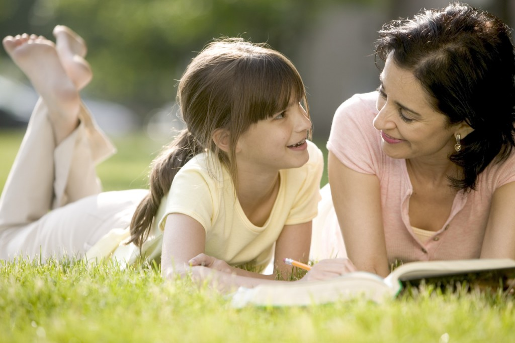Mother Helping Daughter with Her Homework