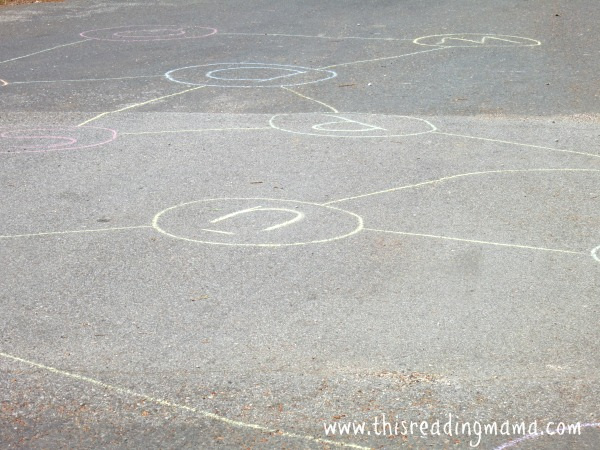 writing letters with sidewalk chalk for sight word game