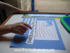 child pointing to text as saying words
