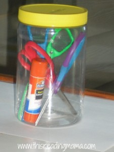 peanut butter jar for scissors and glue sticks