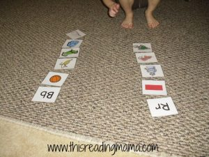 sorting letter sounds on the floor