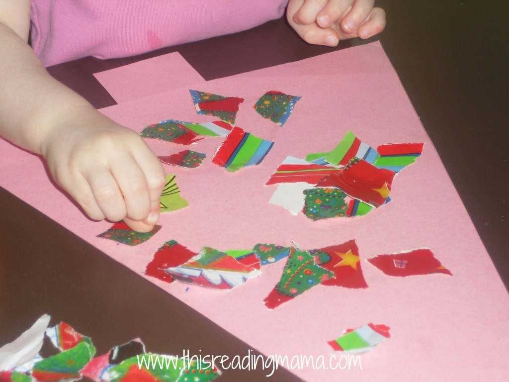 photo of gluing down torn wrapping paper onto Christmas tree