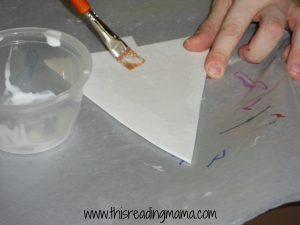 painting glue with paintbrush