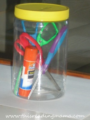 photo of peanut butter jar used for holding school supplies