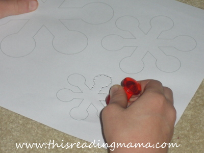 photo of using push pins to make holes in paper, fine motor