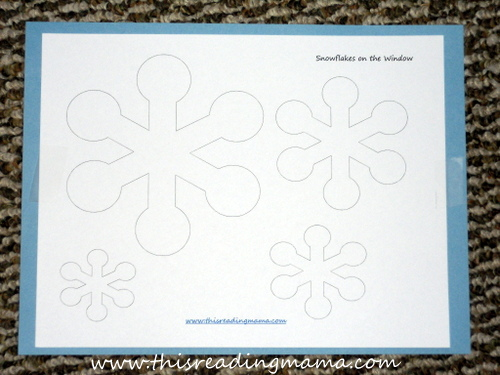 snowflake poke pages with construction paper