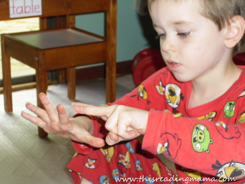 photo of Solving addition problems, counting on fingers | This Reading Mama