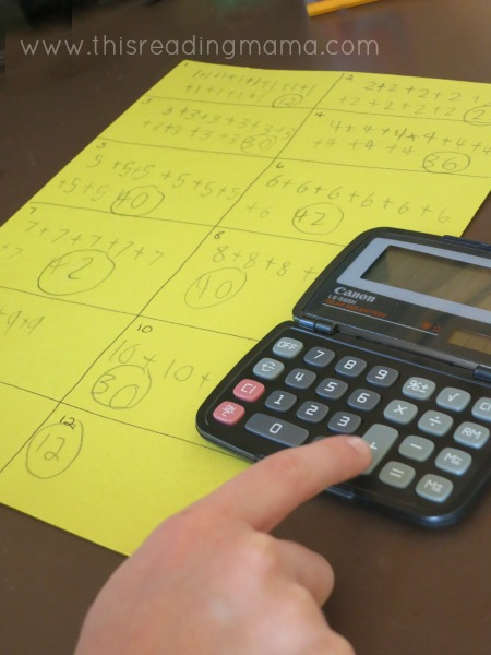 using a calculator to add sums