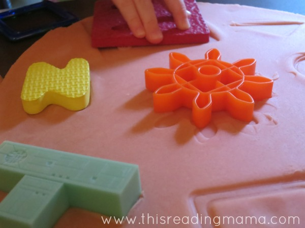 placing objects in playdough puzzles