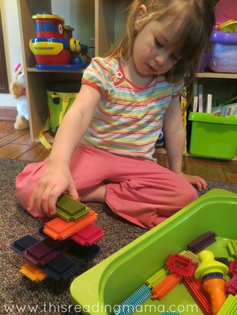 playing with quiet toys during read aloud time