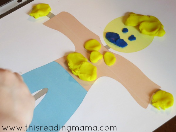 decorating the scarecrow from fall playdough mats