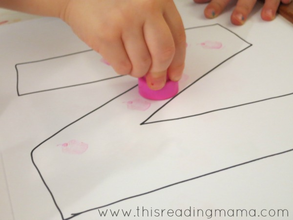 stamping on the letter N