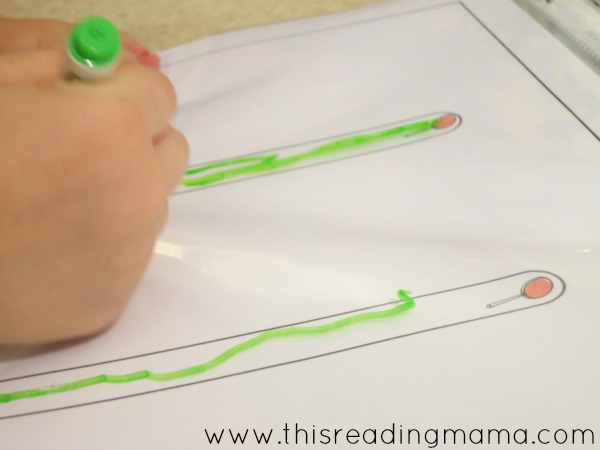 tracing the letter l in our handwriting notebook