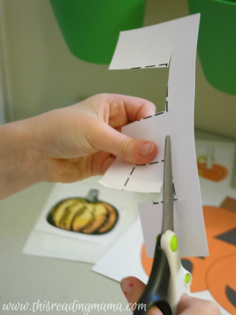 cutting out shapes with pumpkin cut it out pack