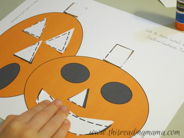 gluing down shapes to form a picture
