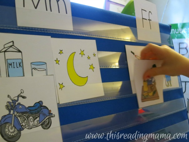 sorting pictures by beginning sound on pocket chart