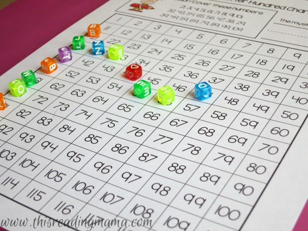 using beads to cover hundreds chart mystery letter page