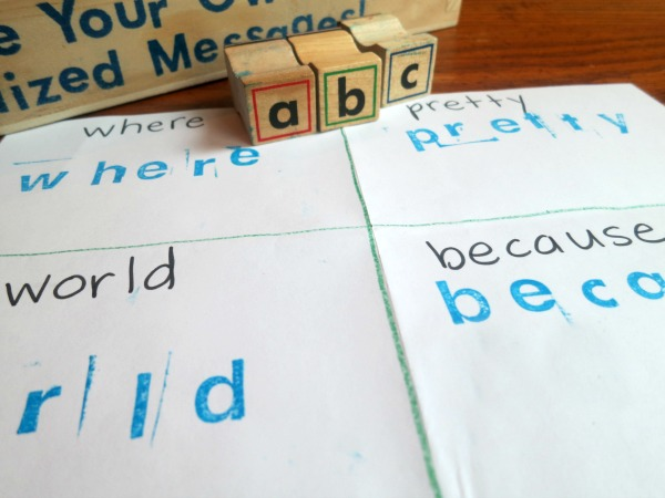 stamping sight words on folded paper