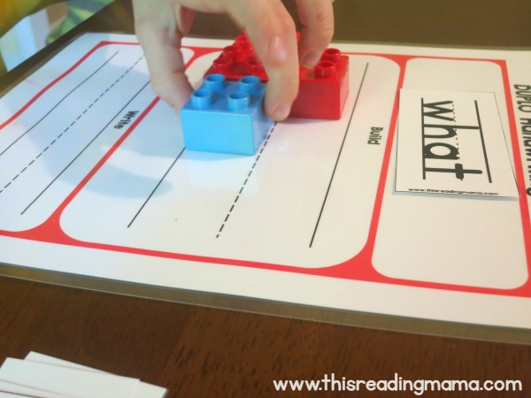 building the shape of the word with DUPLO bricks