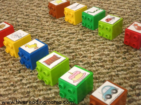 setting up DUPLO bricks for rhyming word matching game