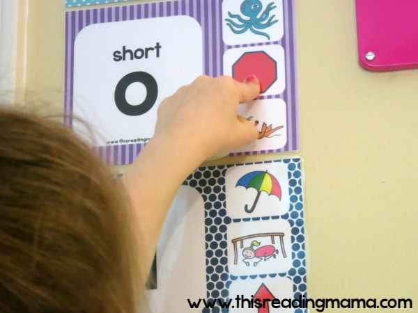 using pictures on the wall charts to remember the short vowel sounds