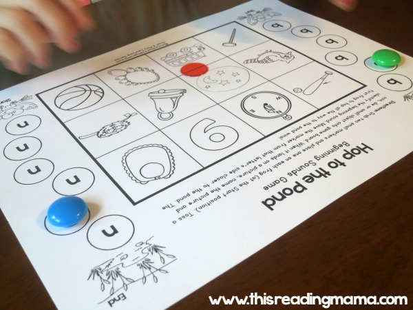 tossing manipulative on the beginning sounds game board