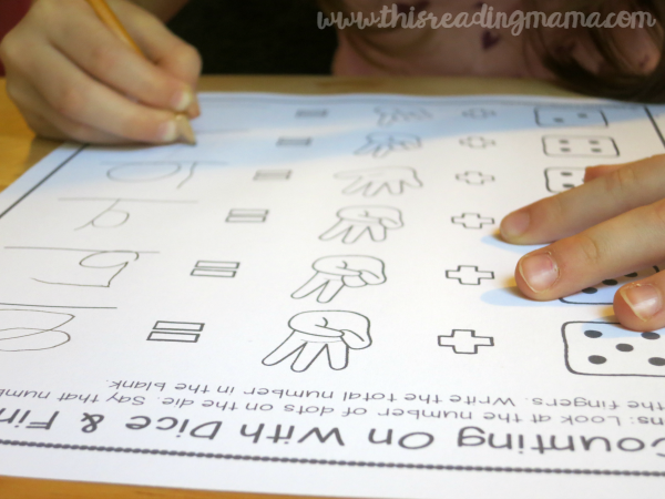 counting on page with dice and fingers