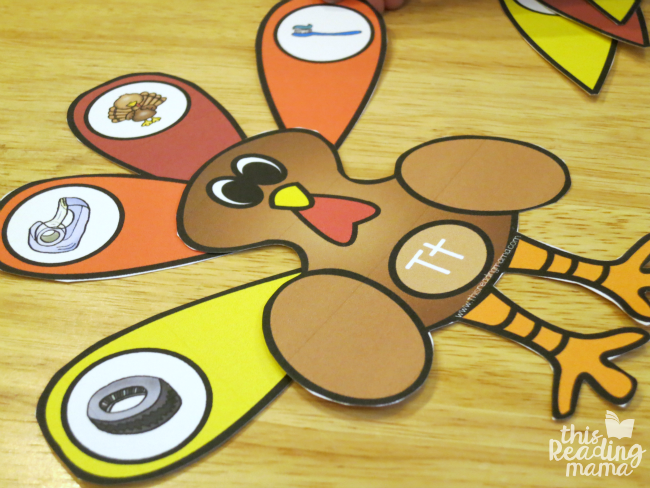 sorting beginning sounds with turkey feathers