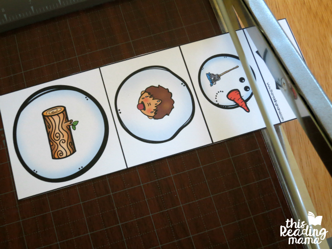 cutting out snowmen with paper cutter