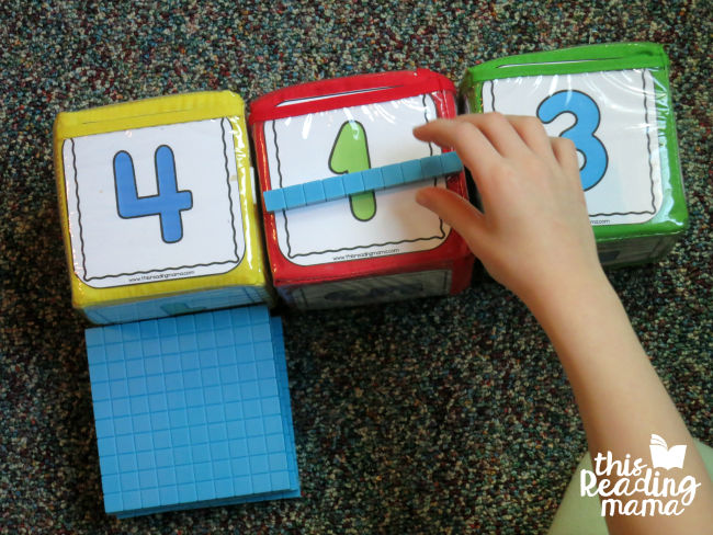 roll and build a 3-digit number with base ten blocks