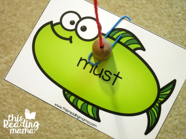 sight word fishing game - catching a fish with magnetic pole and paper clip