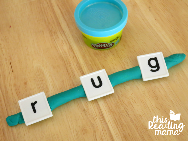 sounding out words with playdough snake and letter tiles