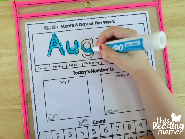 coloring in the month on the preschool calendar page