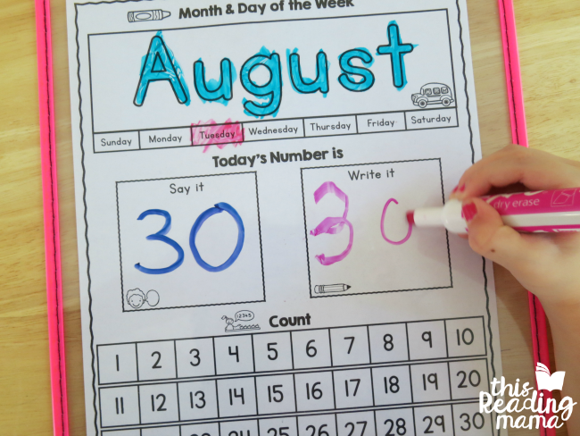 writing today's number on the preschool calendar page