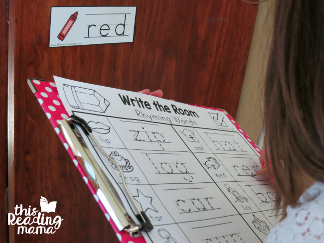 writing the rhyming words on recording sheet from write the room