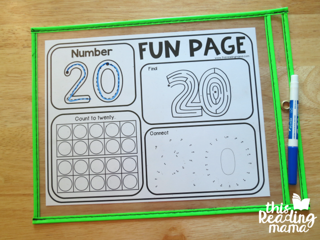 slip number fun pages into dry erase pocket to make them reusable