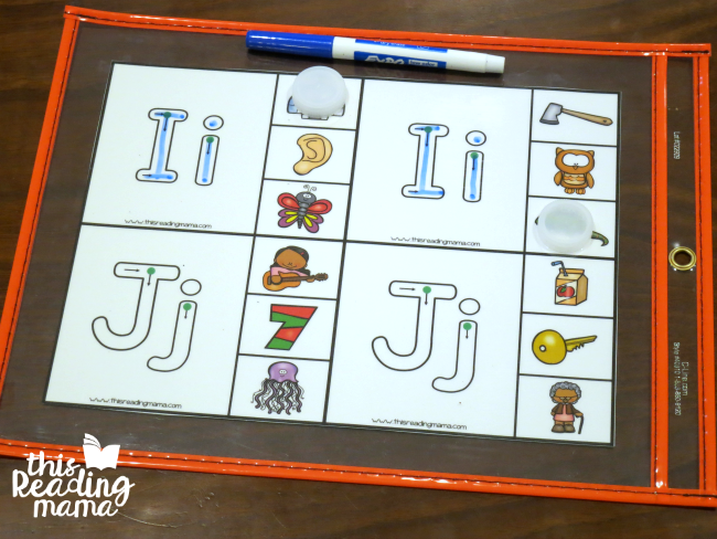 put beginning sounds clip cards into a dry erase pocket