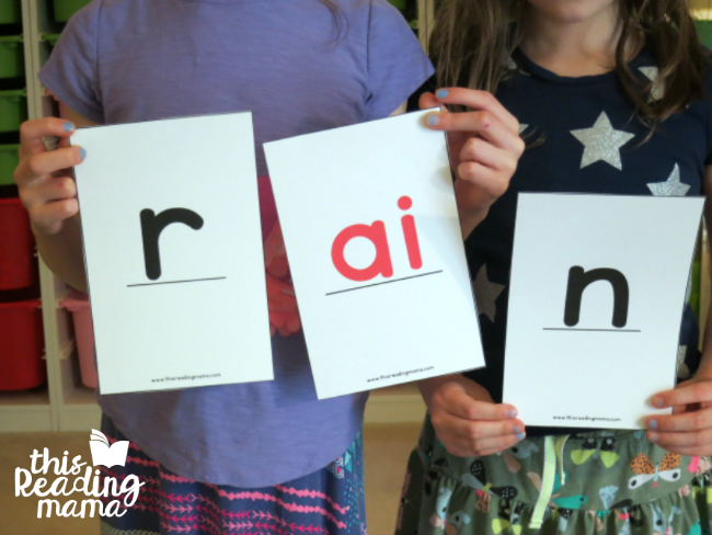 "spelling ""rain"" with oversized digraph cards"